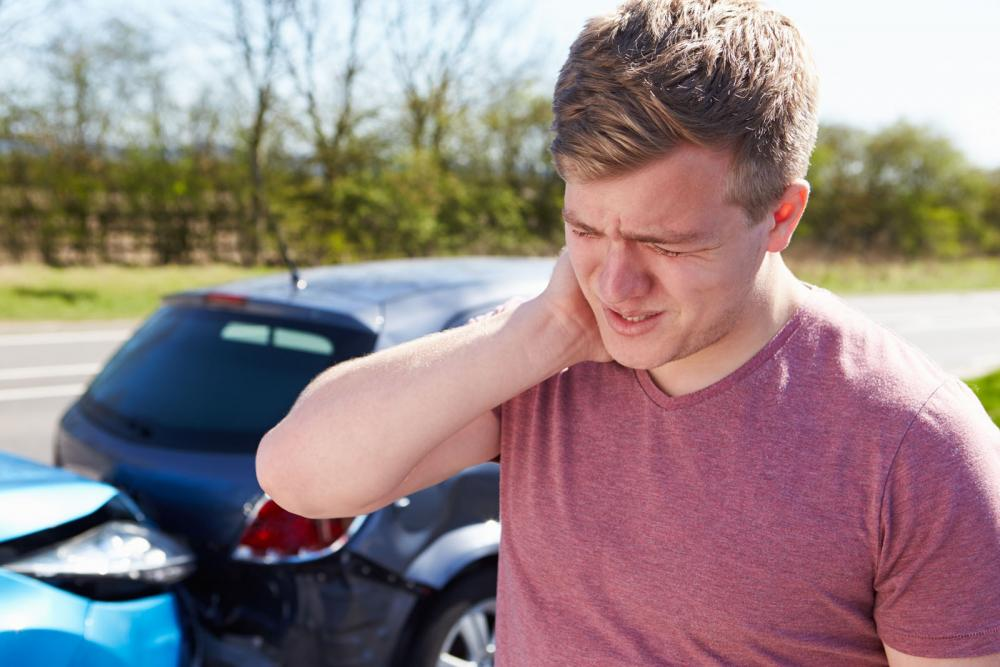 Man with whiplash after a car accident.